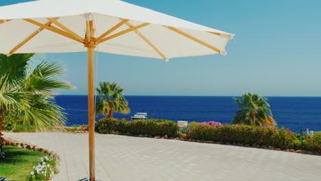 A-Row-Of-White-Umbrellas-Against-The-Blue-Sky-In-A-Luxury-Hotel-2