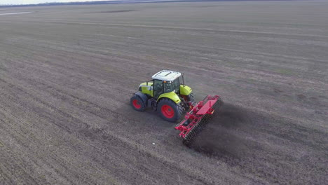 Aerial-Tracking-Video:-Tractor-Processes-The-Soil-On-The-Field-Moves-Along-The-Diagonal-Of-The-Frame