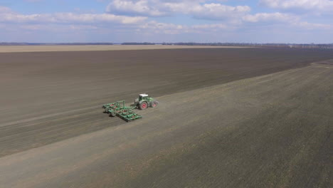 Aerial-Tracking-Video:-Tractor-Processes-The-Soil-On-The-Field-Moves-Along-The-Diagonal-Of-The-Frame-1