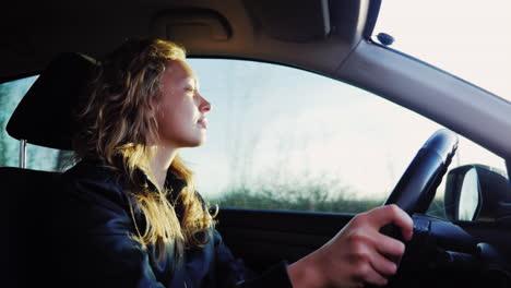 Woman-Drives-The-Car-At-Sunset-1