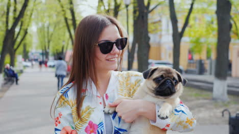 Young-Woman-Walks-With-A-Puppy-In-The-City