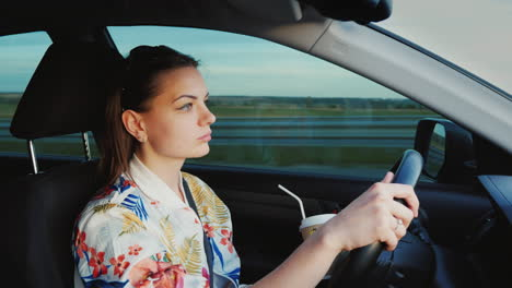 A-Young-Woman-Is-Driving-A-Car-Leisurely-Driving-For-Fun