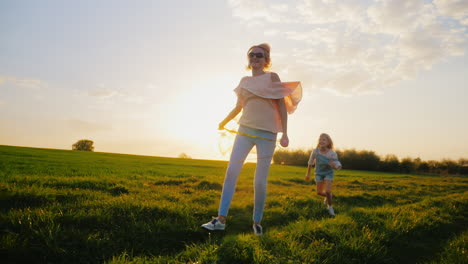 Carefree-Young-Woman-With-Balloons-Walking-On-A-Green-Meadow-At-Sunset-2