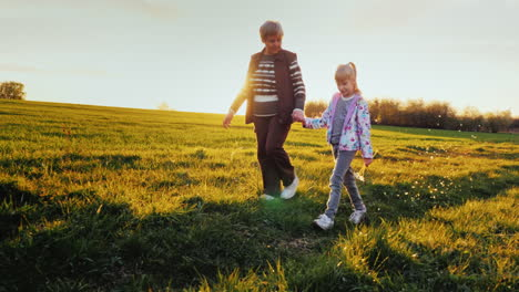 Grandmother-And-Granddaughter-Are-Walking-Around-The-Countryside-2