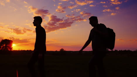 Father-And-Son-Are-Walking-Along-The-Field-At-Sunset-1