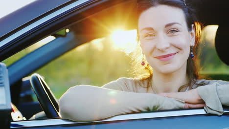 Attractive-Woman-Looks-Out-The-Car-Window-Portrait