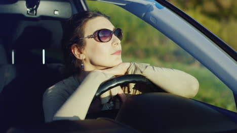 A-Woman-In-Sunglasses-Relaxes-In-The-Car