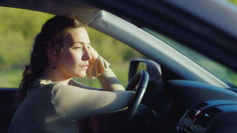 Portrait-Of-Caucasian-Woman-Crying-In-Car-1