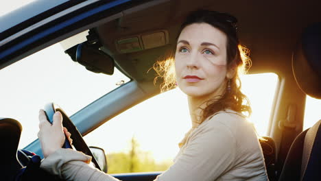 Attractive-Woman-Looks-Out-The-Car-Window-Portrait-1