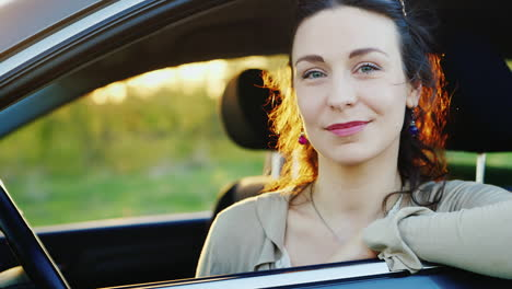 Attractive-Woman-Looks-Out-The-Car-Window-Portrait-2