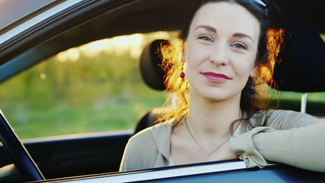 Attractive-Woman-Looks-Out-The-Car-Window-Portrait-3