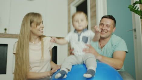 Young-Caucasian-Parents-Play-With-Their-Baby-Boy
