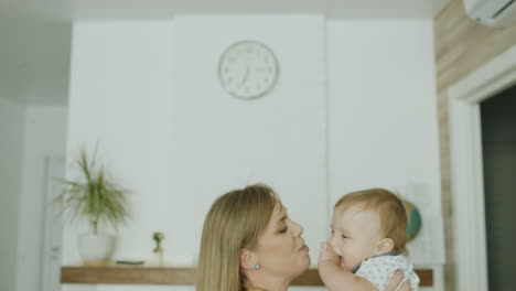 Young-Caucasian-Mother-Plays-With-Her-Young-Son-Indoors