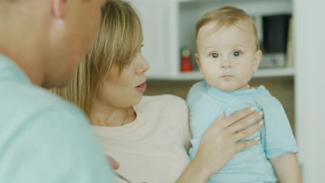 Young-Parents-Play-With-Their-Little-Son-While-They-Try-To-Feed-Him-From-A-Spoon-3