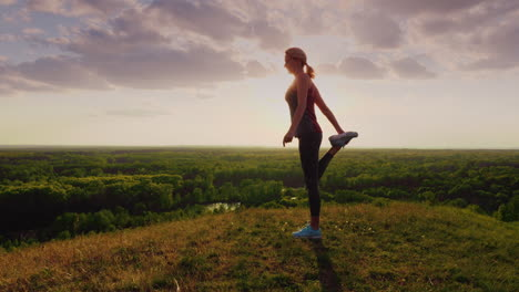 Young-Woman-Doing-Stretching-Exercise-In-An-Epic-Beautiful-Place-At-Sunset