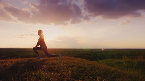 Young-Woman-Doing-Stretching-Exercise-In-An-Epic-Beautiful-Place-At-Sunset-1