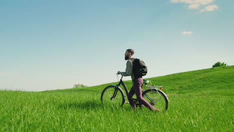 A-Young-Bearded-Man-Is-Riding-A-Bicycle-1
