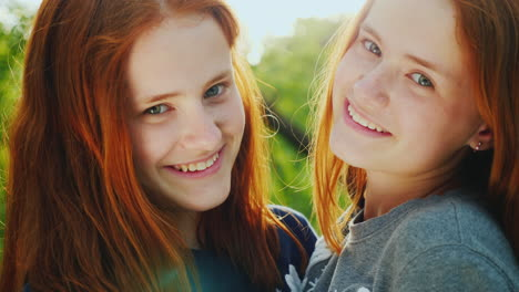Close-Up-Portrait-Of-Two-Happy-Sisters-Twins