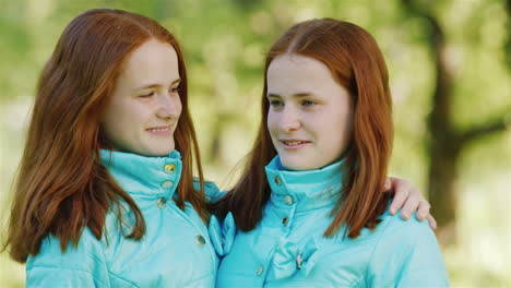 Close-Up-Portrait-Of-Two-Happy-Sisters-Twins-1