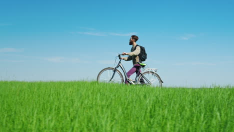A-Young-Bearded-Man-Is-Riding-A-Bicycle-2