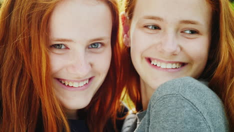 Close-Up-Portrait-Of-Two-Happy-Sisters-Twins-3