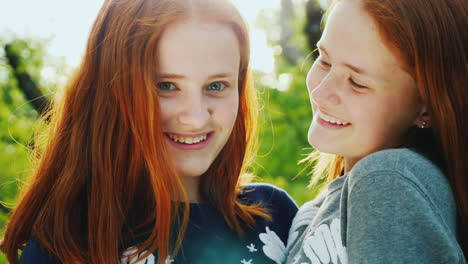 Close-Up-Portrait-Of-Two-Happy-Sisters-Twins-4