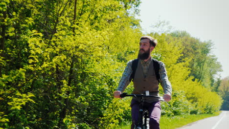 Bearded-Hipster-Riding-On-A-Bike-On-A-Clear-Spring-Day-1