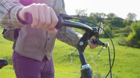 A-Man-Drives-A-Bicycle-Through-A-Green-Meadow