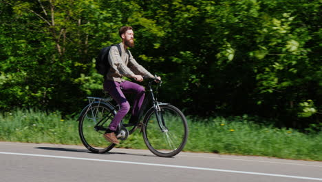 Side-View-Of-A-Young-Man-Riding-A-Bicycle