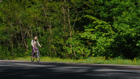 Low-Angle-Shot:-Man-Riding-A-Bicycle