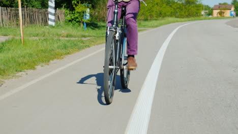 Tilt-Shot-Of-Man-Riding-A-Bicycle