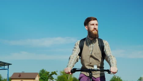 Portrat-Of-Man-Riding-A-Bicycle