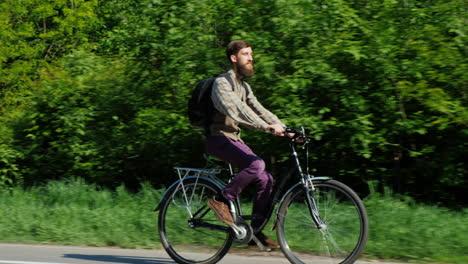 Man-Riding-A-Bicycle-1
