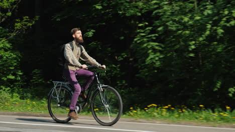 Man-Riding-A-Bicycle-2