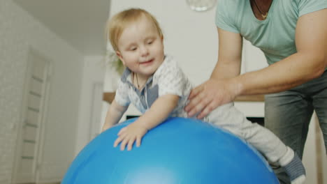 Dad-Plays-With-His-Young-Son-At-Home