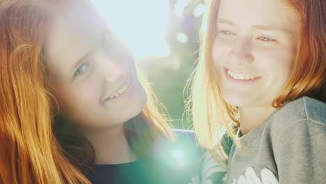 Portrait-Of-Happy-Twin-Sisters