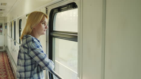 Woman-Traveling-On-The-Train-Looking-Out-The-Window