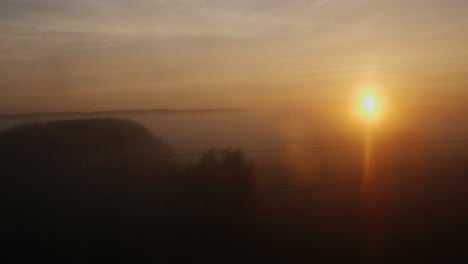 The-Rising-Sun-From-The-Window-Of-A-Moving-Train-Or-Car