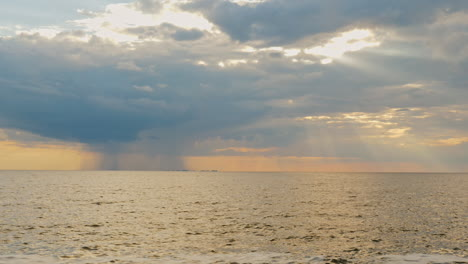 Strong-Rain-Far-Into-The-Sea-And-The-Setting-Sun-With-Beautiful-Rays