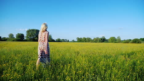 A-Woman-Is-Walking-Along-A-Beautiful-Meadow-With-Flowers-At-Sunset-Only-The-Legs-Are-Visible-In-The-Frame-1