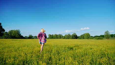 A-Woman-Runs-Along-A-Beautiful-Meadow-With-Flowers-At-Sunset-Only-The-Legs-Are-Visible-In-The-Frame-1