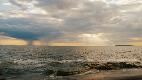 Sunset-By-The-Sea-Where-The-Rays-Of-The-Sun-Shine-From-A-Thundercloud