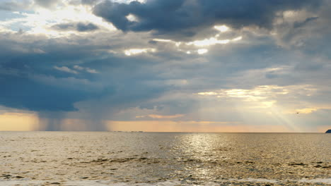 Strong-Rain-Far-Into-The-Sea-And-The-Setting-Sun-With-Beautiful-Rays-1