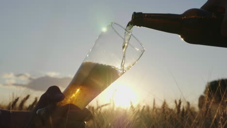 Pour-The-Cold-Beer-Into-The-Glass-From-The-Bottle