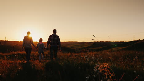Steadicam-Shot:-A-Family-Of-Three-People-Meets-The-Sunrise-In-A-Picturesque-Place-On-The-Mountain