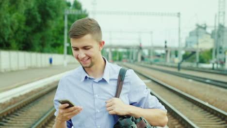A-Good-Looking-Young-Businessman-Walks-Along-The-Railway-Platform