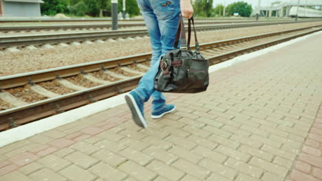 A-Man-With-A-Travel-Bag-Goes-Along-The-Railroad
