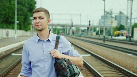 A-Good-Looking-Young-Businessman-Walks-Along-The-Railway-Platform-2