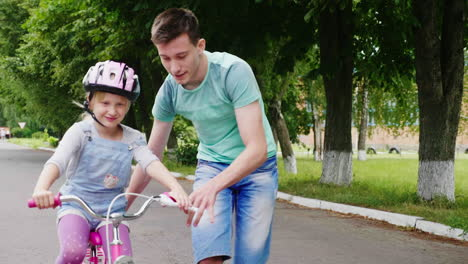 The-Elder-Brother-Teaches-His-Sister-How-To-Ride-A-Bicycle-The-First-Successes-Of-Children