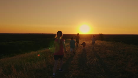 A-Group-Of-Children-Are-Running-Happily-Towards-The-Sunset-With-The-Dog